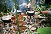 Rangers cook lunch in a small camp whilst on patrol. The forest rangers are employed by the Ministry of Environment but sponsored by Flora and Fauna International who pays them 75% of their salary and provides training and accommodation. They undertake regular patrols in to the Samkos Wildlife Sancturary which is part of the Cardamom Mountains Nature Reserve looking for illegal activites such as logging, poaching, land encroachment and the production of the illegal substance sassafras oil. The Cardamom Mountains and surrounding forests is the largest and most pristine area of intact forest in SE Asia. Covering an area of 2.5 million acres it became one of the last strong holds of a retreating Khmer Rouge. Their presence helped preserve the forest as no-one dared to venture inside. But with the Khmer Rouge gone, it faces new dangers from poachers, loggers and illegal drug factories. In charge of protecting this vast forest are a handful of rangers who's job it is to track down and arrest those who are helping to destroy this delicate habitat.