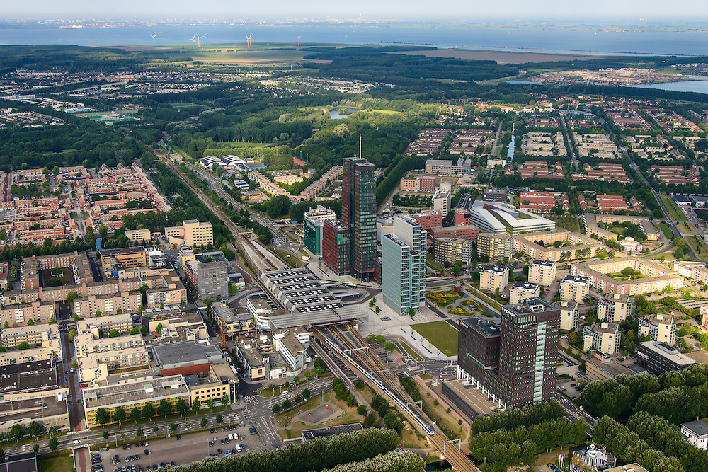 Nederland, Flevoland, Almere, 27-08-2013; Stadshart, met  RABObank en USG, Station NS en WTC. In de achtergrond het IJmeer en de skyline van Amsterdam.<br /> Heart of the newly constructed city of Almere, right center high-rise offices (Rabobank, WTC  and employment agency USG ) and the railway station. <br /> On the horizon the skyline of Amsterdam. <br /> luchtfoto (toeslag op standaard tarieven);<br /> aerial photo (additional fee required);<br /> copyright foto/photo Siebe Swart.