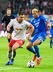 LEIPZIG, Feb. 26, 2019  Leipzig's Willi Orban (L) vies with Hoffenheim's Joelinton during a German Bundesliga match between RB Leipzig and TSG 1899 Hoffenheim in Leipzig, Germany, on Feb. 25, 2019. The match ended in a 1-1 draw. (Credit Image: © Kevin Voigt/Xinhua via ZUMA Wire)