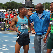 JOHNSON - 13USA, Des Moines, Ia.  - Former great 800 runner Johnny Gray, flanked by Brandon Johnson, left, and Duane Solomon, just informed Solomon that he had finished third place and made the USA World Championship team.  Solomon was the winner in a fast 1:43.27. Photo by David Peterson