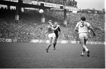 The All Ireland Senior Football Final.1982.19.09.1982.09.19.1982.19th September 1982..The senior final was contested between Offaly and Kerry. Offaly won the title by the narrowest of margins 1.15 to 17 points..A kerry attacker takes his point as the defender and referee look on..