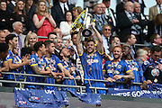 AFC Wimbledon defender Jon Meades (12) lifting the trophy during the Sky Bet League 2 play off final match between AFC Wimbledon and Plymouth Argyle at Wembley Stadium, London, England on 30 May 2016.