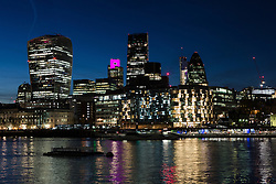© Licensed to London News Pictures. 04/062016. LONDON, UK.  Tower 42 on the City of London skyline is illuminated in hot pink to mark the London Mayoral and local elections taking place on 5th May and remind Londoners to visit their polling stations and vote. City Hall is one of a number of landmarks across London that are being illuminated in hot pink this evening.  Photo credit: Vickie Flores/LNP