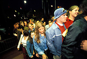 Large crowd queuing to get into a club, UK 2000's