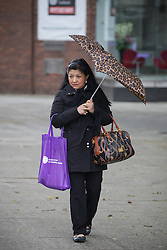 © Licensed to London News Pictures. 05/05/2015. Bristol, Avon, UK. A woman walking under her umbrella in the rain in Bristol this morning, 5th May 2015. Rain showers and strong, blustery winds have been sweeping up the South West of England, with brighter, but still windy weather expected later. Photo credit : Rob Arnold/LNP