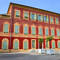 Musée Matisse Art Museum in Nice, France <br /> Henri Matisse was a famous French painter and sculptor who lived in Nice for 37 years until his death in 1954.  A huge collection of his work that is dominated by bold colors and stylized portraits are housed in this three-story, red building that was called Villa des Arénes when it was built in 1685.  The Musée Matisse opened on Cimiez Hill in 1963.  Some of his works have been auctioned for $9 to $25 million.
