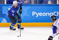 GANGNEUNG, SOUTH KOREA - FEBRUARY 17: Jan Mursak of Slovenia vs Michal Cajkovsky of Slovakia during the ice hockey match between Slovenia and Slovakia in  the Preliminary Round on day eight of the PyeongChang 2018 Winter Olympic Games at Kwangdong Hockey Centre on February 17, 2018 in Gangneung, South Korea. Photo by Kim Jong-man / Sportida