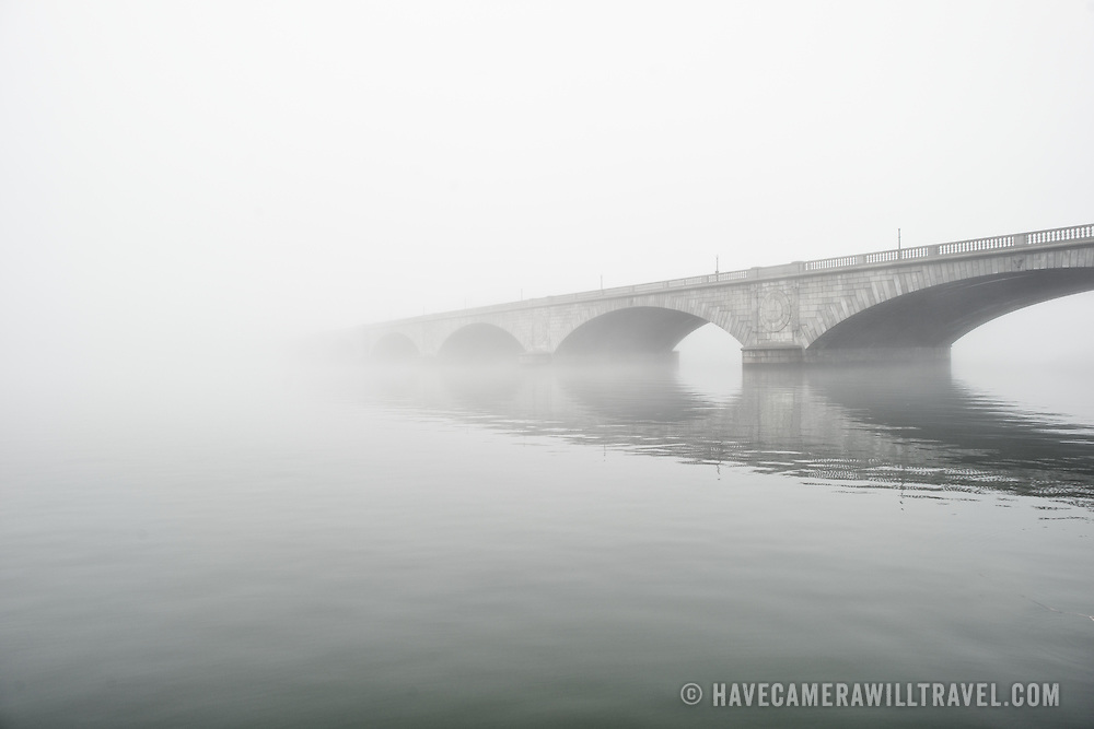 Memorial Bridge disappears into heavy mist on a cold winter's day in Washington DC.