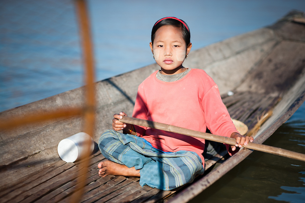 Fishing girl on boat on Inle Lake