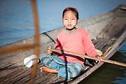 Fishing girl on boat on Inle Lake