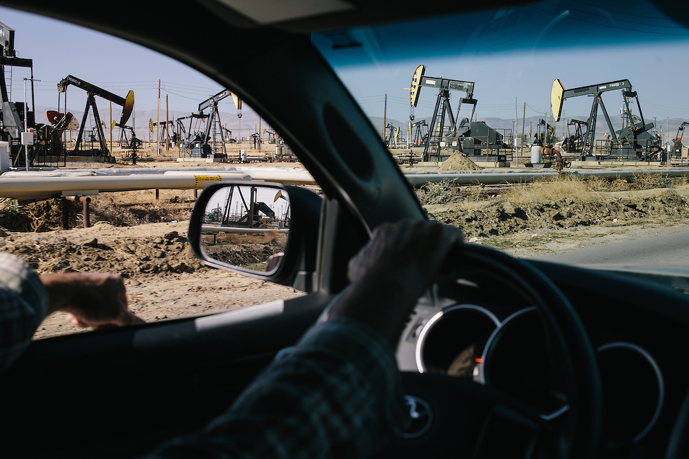 Environmental Activist and almond farmer Tom Frantz, drives through the Belridge Oil Field to prepare for a tour he'll give to State water officials.
