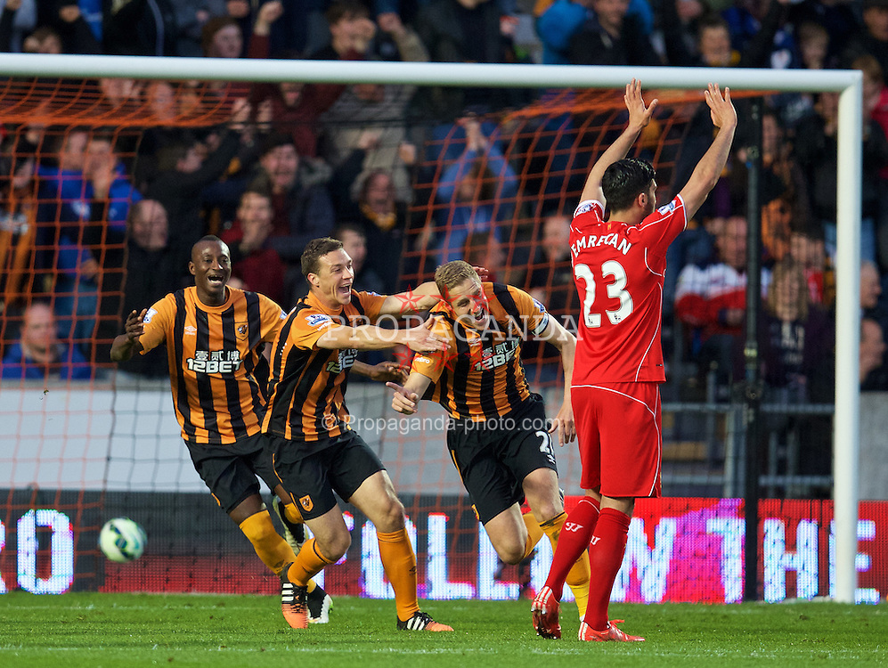 KINGSTON-UPON-HULL, ENGLAND - Tuesday, April 28, 2015: Hull City's Michael Dawson celebrates scoring the only goal of the game against Liverpool during the Premier League match at the KC Stadium. (Pic by David Rawcliffe/Propaganda)
