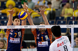 Matevz Kamnik and Andrej Flajs of ACH vs Neves Leandro Vissotto of Trentino at 2nd Semifinal match of CEV Indesit Champions League FINAL FOUR tournament between ACH Volley, Bled, SLO and Trentino BetClic Volley, ITA, on May 1, 2010, at Arena Atlas, Lodz, Poland. Trentino defeated ACH 3-1. (Photo by Vid Ponikvar / Sportida)