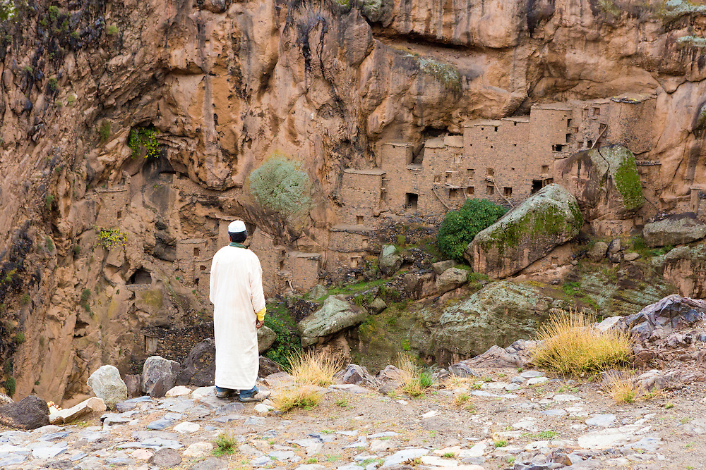 TALIOUINE, MOROCCO - OCTOBER 25TH 2015 - Key Keeper Abdullah stands infront of the Tizgui Granary (Agadir Tizgui), Taliouine province, Souss Massa Draa, Southern Morocco.