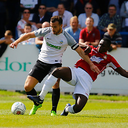 AUGUST 12:  Dover Athletic against Wrexham in Conference Premier at Crabble Stadium in Dover, England. Wrexham's defender Manny Smith puts in a heavy challenge on Dover's midfielder Mitch Brundle. (Photo by Matt Bristow/mattbristow.net)