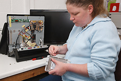 Woman with a mild learning disability working as a trainee computer technician,  helped into employment by the Ready 4 Work team, Nottinghamshire County Council