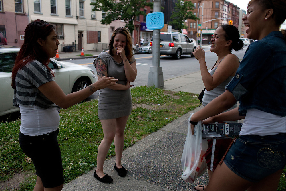 Damaris Pollock, Emily Perez, Wendy Feliciano and Dekenna Davis  on Fulton Street near the Broadway Junction A train stop in Brooklyn, NY on June 24, 2012.