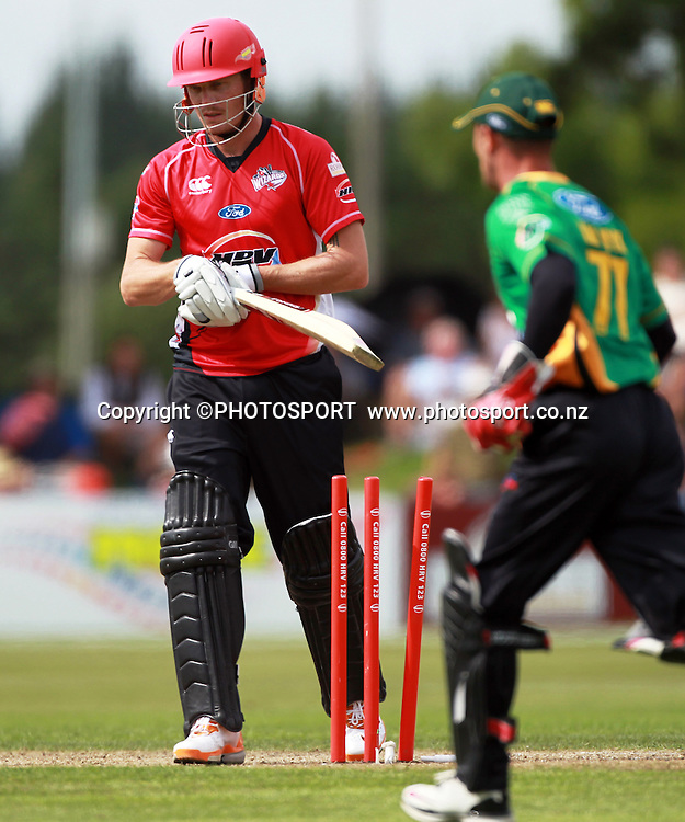 Canterbury player Rob Nicol after being bowled by Doug Bracewell, with Kruger van Wyk. Canterbury Wizards v Central Stags. HRV Cup, Twenty20 men's cricket match, Mainpower Oval, Rangiora, Sunday 8 January 2012. Photo : Joseph Johnson / photosport.co.nz