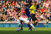 Stoke City's Bojan Krkic is nudged off the ball by Leicester City's Danny Drinkwater during the Barclays Premier League match between Stoke City and Leicester City at the Britannia Stadium, Stoke-on-Trent, England on 19 September 2015. Photo by Aaron Lupton.