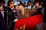 "Shouting predatel, or ""traitor,"" a flag-waving colonel of the Soviet Army confronts one of thousands of demonstrators shouting ""Down with the Empire of Red Fascism"" at May Day parade on Red Square in 1990. Muscovites jeered President Mikhail Gorbachev and the Soviet leadership, turning a working-class holiday into an angry display of popular discontent with Communist rule -- a movement that would lead to the dissolution of the Soviet Union in December 1991.  © Steve Raymer / National Geographic Creative"