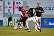 Hiram Boateng (44) of Exeter City battles for possession with Elliott Whitehouse (4) of Lincoln City during the EFL Sky Bet League 2 match between Exeter City and Lincoln City at St James' Park, Exeter, England on 17 May 2018. Picture by Graham Hunt.