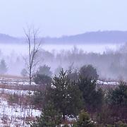 Fog Settles On A Unseasonably Warm Morning In Charlevoix