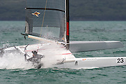 Ray Davies (NZL273) rounds the top mark in race four of the A Class World championships regatta being sailed at Takapuna in Auckland. 12/2/2014