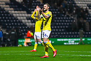 Liam Cooper of Leeds United (6) claps the Leeds fans after the EFL Sky Bet Championship match between Preston North End and Leeds United at Deepdale, Preston, England on 9 April 2019.