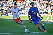 Peterborough United midfielder Mark O'Hara (8) knocks the ball past Blackpool defender Oliver Turton (20)  during the EFL Sky Bet League 1 match between Peterborough United and Blackpool at The Abax Stadium, Peterborough, England on 29 September 2018.