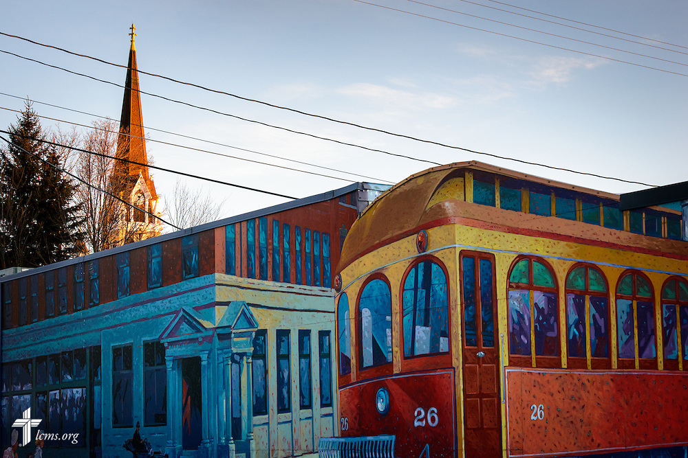 Exterior photograph of St. John's Lutheran Church set against murals in downtown Plymouth, Wis., on Friday, Jan. 29, 2016. LCMS Communications/Erik M. Lunsford