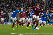 Ryan Jack of Rangers FC & Steven Naismith of Hearts tangle during the Betfred Scottish League Cup semi-final match between Rangers and Heart of Midlothian at Hampden Park, Glasgow, United Kingdom on 3 November 2019.