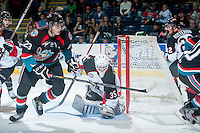 KELOWNA, CANADA - OCTOBER 19: Justin Kirkland #23 of the Kelowna Rockes skates for the puck after a save by Ty Edmonds #35 of the Prince George Cougars on October 19, 2013 at Prospera Place in Kelowna, British Columbia, Canada.   (Photo by Marissa Baecker/Shoot the Breeze)  ***  Local Caption  ***
