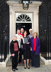 ©under licence to London News Pictures. 18/05/11. London, UK  . Campaigners from Lewisham, Camden & Swindon assembled to protest against the cuts at Department of Culture, Media and Sport, and then delivered a petition to 10 Downing Street. Picture shows representatives of the campaign about to hand in their petition to No 10. Please see special instructions for usage rates. Photo credit should read TONY NANDI/LNP