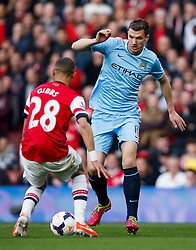 Man City Forward Edin Dzeko (BIH) is challenged by Arsenal Defender Kieran Gibbs (ENG) - Photo mandatory by-line: Rogan Thomson/JMP - 07966 386802 - 29/03/14 - SPORT - FOOTBALL - Emirates Stadium, London - Arsenal v Manchester City - Barclays Premier League.