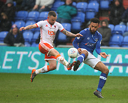 Jay Spearing of Blackpool (L) and Aaron Holloway of Oldham Athletic in action - Mandatory by-line: Jack Phillips/JMP - 02/04/2018 - FOOTBALL - Sportsdirect.com Park - Oldham, England - Oldham Athletic v Blackpool - Football League One