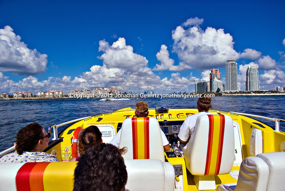 Thriller speedboat tour enters Government Cut with downtown Miami straight ahead, Fisher Island ahead left and Miami Beach ahead right. WATERMARKS WILL NOT APPEAR ON PRINTS OR LICENSED IMAGES.
