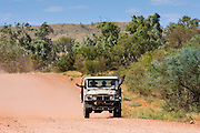 Aborigines in four-wheel-drive vehicle, Mereenie-Watarrka Road, Red Centre, Australia