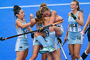 Florencia Habif of Argentina (16) (being held up) scores a goal and celebrates with team mates during the Vitality Hockey Women's World Cup 2018 Pool C match between Germany and Argentina at the Lee Valley Hockey and Tennis Centre, QE Olympic Park, United Kingdom on 25 July 2018. Picture by Martin Cole.