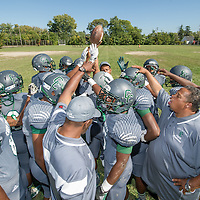Detroit's Cody High School Varsity football team on practice field before before playing first game on new field.