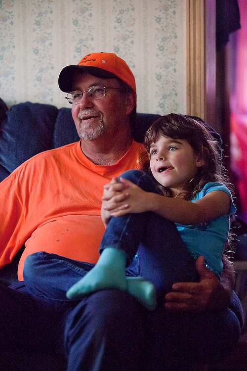 On a rainy afternoon, Dale Payne and Kiera Volz relax on the couch while watching the Disney channel at their Huntingburg home May 14. Payne says he knows more about princesses and other cartoon characters than most guys his age. Dale, who has known Kiera since she was born, has helped raise her since July 2010 and became her legal guardian in October 2011.
