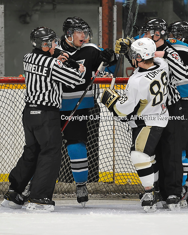 TRENTON, ON - Feb 10 : Ontario Junior League Action between Lindsay Muskies at Trenton Golden Hawks. Linesman Ryan Dekairelle holds back a Lindsay Muskie's player from fighting with Krystian Yorke #88 of the Trenton Golden Hawks during second period game action.(Photo by Amy Deroche / OJHL Images)