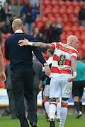 Richard Chaplow of Doncaster Rovers and Rob Jones at end of match the Sky Bet League 1 match between Doncaster Rovers and Barnsley at the Keepmoat Stadium, Doncaster, England on 3 October 2015. Photo by Ian Lyall.