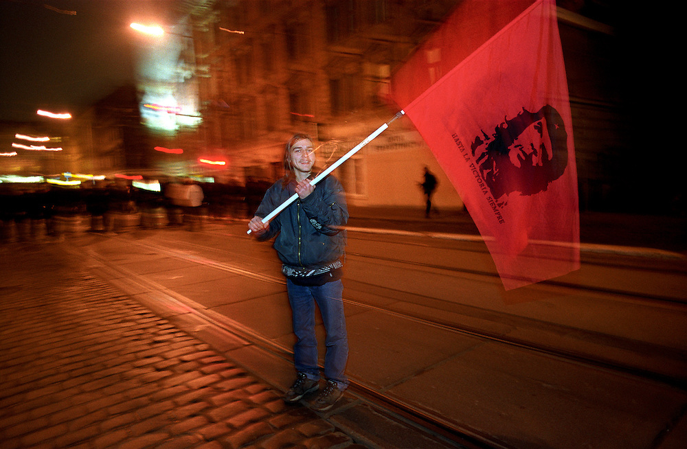 Young protester with a Che Guevara flag during a demonstration against the Nato summit in Prague.