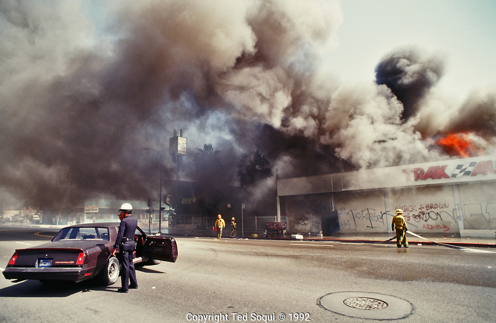 A Trak Auto store is looted and burned on Washington Blvd. near Norton Ave.