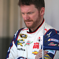 NASCAR Sprint Cup driver Dale Earnhardt Jr. is seen in the garage area, during a NASCAR Daytona 500 practice session at Daytona International Speedway on Wednesday, February 20, 2013 in Daytona Beach, Florida.  (AP Photo/Alex Menendez)