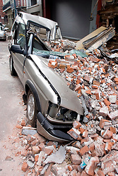 10 Sept 2005. New Orleans, Louisiana.  Hurricane Katrina aftermath. <br /> Vehicles lay crushed under the rubble of a collapsed building just off Canal Street in the heart of downtown. A land rover makes it's last voyage of Discovery.<br /> Photo; ©Charlie Varley/varleypix.com