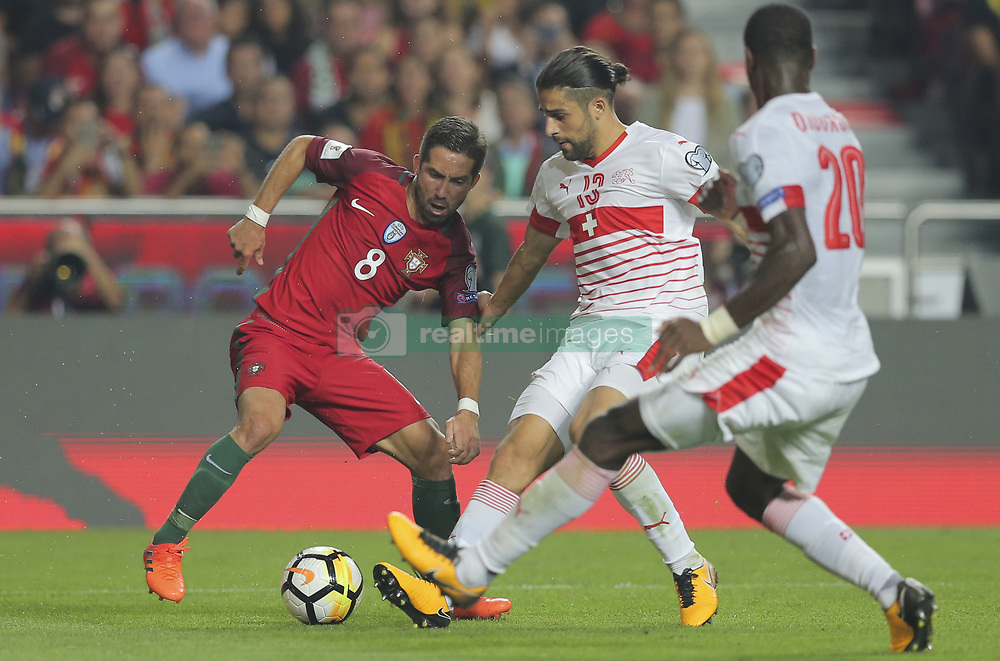 October 10, 2017 - Na - Lisbon, 10/10/2017 - The Portuguese football team received their Swiss counterpart tonight in the last game of the group stage to qualify for the 2018 FIFA World Cup in Russia , next June. Portugal won 2-0 to reach the final. João Moutinho  (Credit Image: © Atlantico Press via ZUMA Wire)