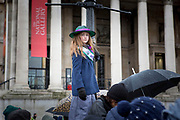UNITED KINGDOM, London: 04 March 2018 Chelsey Brown, aged 8 and dressed as a Suffragette, listens to the speeches during the #March4Women rally at Trafalgar Square this afternoon. Thousands of people marched through London to celebrate International Women's Day and 100 years since the first women in the UK gained the right to vote. <br /> Rick Findler / Story Picture Agency