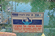 Danger of drowning sign at Alumot Dam. A dam on the Southern (or lower) Jordan river 3 KM south of the Sea of Galilee that essentially blocks all water flow towards the Dead Sea