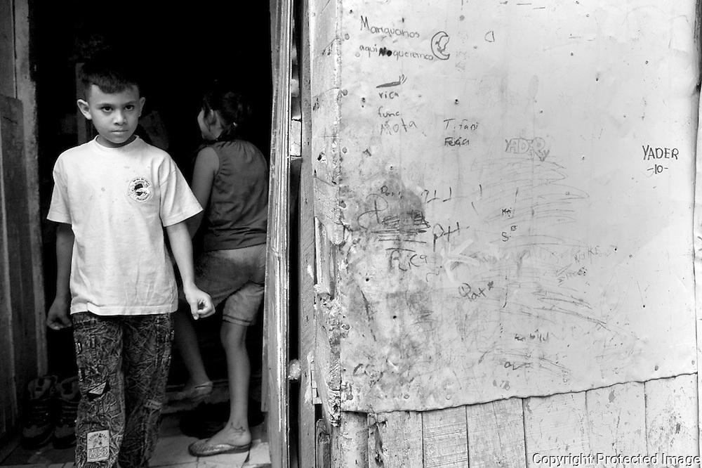 A Boy walks outside of his home in the slum Los Pinos de San Felipe, Alajuelita.